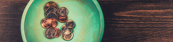 Coins in teal dish.