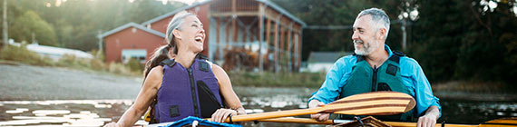 Mature couple on canoes.