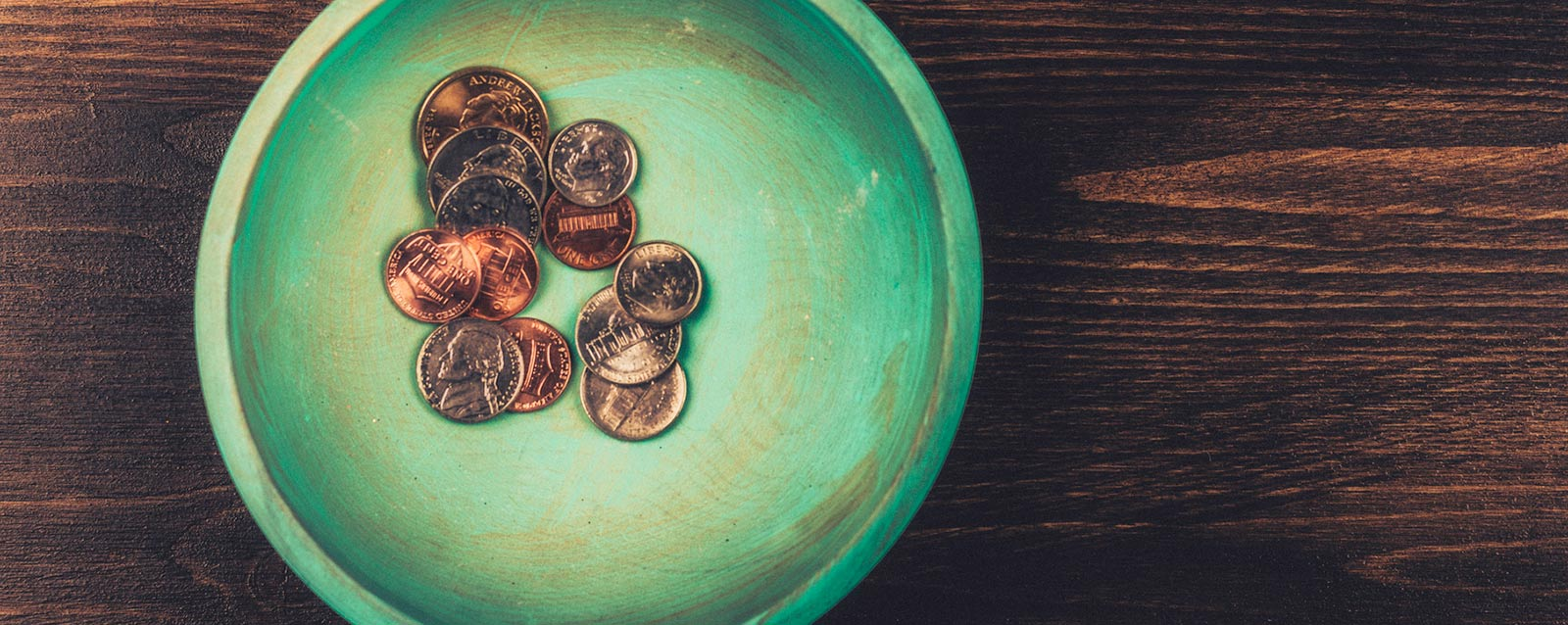 Coins in teal dish